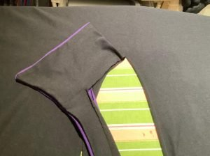 Attaching collar to cape